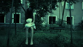 The ghost of a little girl on a swing in the old ruined house. evil spirit