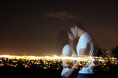 Ghost Lovers. Ghost couple kissing over city lights Royalty Free Stock Photos