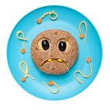 Ghost made of bread. On blue plate Stock Photos
