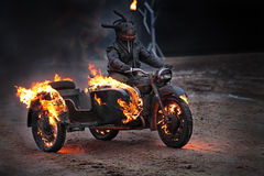 Ghost. A man drives a motorcycle burning Stock Images