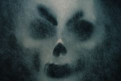 Ghost mask with horror. Ghost mask with horror on a black background Royalty Free Stock Images
