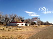 Ghost Motel. A ghost motel in the abandoned city of Glenrio, New Mexico. Sky blue skies and ancient roads make this photo a timeless classic Stock Image