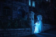 Ghost in night. Portrait of ghost girl in white dress walking in night Royalty Free Stock Photos