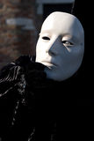 Ghost of past. Man in dark halloween like costume on streets of Venice during carnival Stock Photo