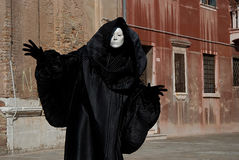 Ghost of past. Man in dark halloween like costume on streets of Venice during carnival Royalty Free Stock Photo
