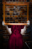Ghost with picture frame Stock Photography