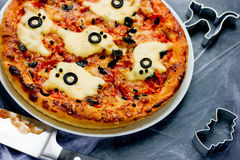 Ghost pizza for Halloween. Selective focus Stock Photos