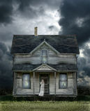 Ghost on Porch in a Storm. Ghost on the porch of an old farmhouse during a storm Royalty Free Stock Photography