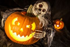 The ghost on the scary pumpkin royalty free stock photo
