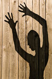 Ghost Shadow on a wooden wall Stock Photos