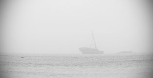 Ghost ship. A distorted and darked corner photo of a ship wreck in sea in a misty weather Stock Images