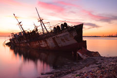 Ghost ship. Abandoned landfill Coast Stock Photography