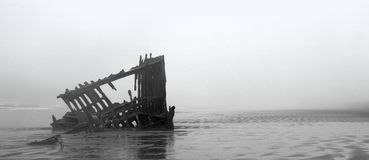 Ghost Ship in Oregon. Ghost ship, shipwreck seen on a foggy beach in Oregon Royalty Free Stock Photos