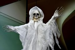Ghost string puppet. Halloween decoration. Ghost marionette with skull and with wide spread arms Stock Photos