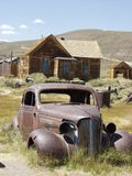 Ghost town. Old car, old house stock photo