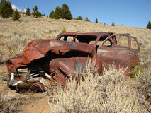 Ghost town car. Old car rests in a Montana ghost town Stock Image