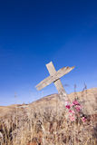 Ghost Town Grave. Old wooden cross marks a lone grave at an old ghost town Stock Photography
