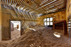 Ghost town Kolmanskop, Namibia. The abandoned ghost diamond town of Kolmanskop in Namibia, which is slowly being swallowed by the desert Royalty Free Stock Image