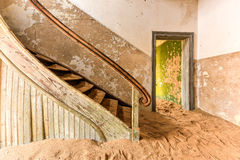 Ghost town Kolmanskop, Namibia. The abandoned ghost diamond town of Kolmanskop in Namibia, which is slowly being swallowed by the desert Stock Photo