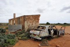 Ghost Town Ruin. Rusty car wreck beside a ruin in the remote ghost town of Silverton in outback Australia Royalty Free Stock Images