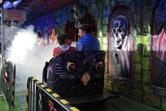 Ghost train in the funfair. LYON, FRANCE, NOVEMBER 2, 2014 : Travelling funfair on Place de la Croix-Rousse, Lyon. The Vogue des Marrons (Funfair of the royalty free stock photo