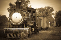 Ghost Train II. Old steam train sitting on the tracks in sepia tones Royalty Free Stock Photography