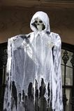 Ghost. A ghost in white rags with a skeleton face for Halloween Royalty Free Stock Image