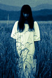 The ghost of a woman. Ghost of a woman in the field royalty free stock photos