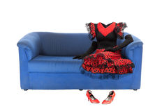 Ghost of the woman on a blue couch | Isolated. Invisible woman in red vintage dress is sitting on a blue couch. Isolated over white Stock Images