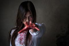 Ghost woman or Zombie reach hand in dark room royalty free stock photo