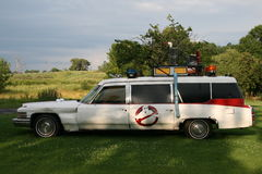 Ghostbusters lookalike automobile. A white Cadillac automobile embellished and designed to look similar to the Ecto-1 vehicle from the movie Ghostbusters stock image