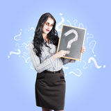 Dead business person with question mark chalkboard. Ghostly business woman asking question on life insurance after death while holding a question mark chalk Royalty Free Stock Photo