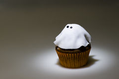 Ghostly cupcake in spot light. For Halloween Royalty Free Stock Photo
