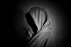 Ghostly figure in the dark. Scary ghostly figure in the dark Stock Images