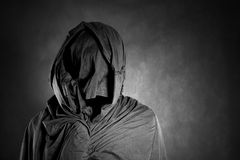 Ghostly figure in the dark. Scary ghostly figure in the dark Stock Photography