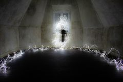Ghostly figure in an empty room. Light painting photography. A Ghostly figure in an empty room. Light painting photography royalty free stock photo