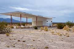 Ghostly gas Station. An eerie ghostly gas station, overgrown and disused in the Mojave desert on route 66 Royalty Free Stock Photo
