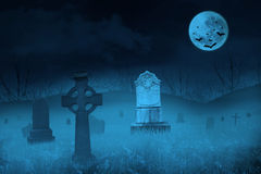 Ghostly graveyard by full moon. Ghostly graveyard under blue full moon for halloween background Stock Photos