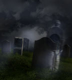 Ghostly man wandering in a cemetery Stock Images