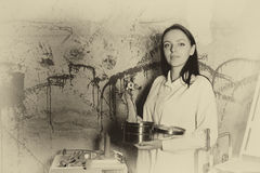 Ghostly monochrome image of a woman holding a severed hand and e Royalty Free Stock Photography