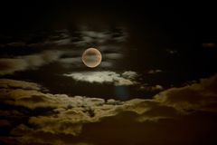 Ghostly Moon. A ghostly full moon and dark clouds at night Royalty Free Stock Image