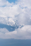 Ghostly mountain peak showing from a cloudy veil. In Bulgarian mountains Royalty Free Stock Photography