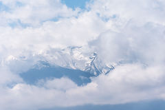Ghostly mountain peak showing from a cloudy veil. In Bulgarian mountains Stock Photography