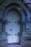 Ghostly old church doors. Moonlight Stock Photo