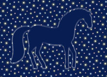 A ghostly silhouette of a horse. In the starry sky Stock Photos