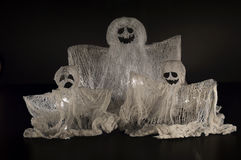Ghosts family on black. Halloween still life with ghosts and candle on black Stock Photos