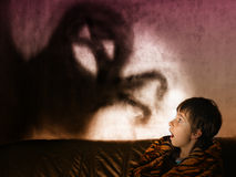 Ghosts at night. The boy is afraid of ghosts at night Stock Photo
