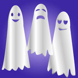 Ghosts. Three funny Ghost on a bright purple background: sad, cheerful and angry ghosts Royalty Free Stock Photography