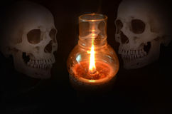Ghosts and wax candle light Stock Image