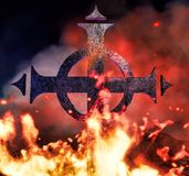 Ghotic cross on fire. The ritual Royalty Free Stock Images